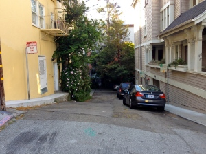 Looking down the south half of Kimball Place which was originally part of Kimball Street. When Dashiell Hammett was writing The Glass Key and editing The Maltese Falcon for book release, he lived in the yellow building at left [address].